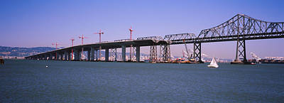 Bay Bridge Photograph - Cranes At A Bridge Construction Site by Panoramic Images