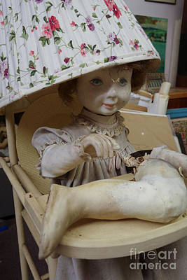 Creepy Old Doll With Broken Leg In A High Chair With A Lampshade Art Print