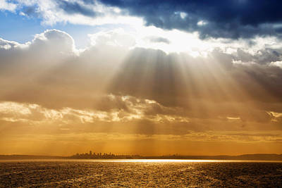 Photograph - Crepuscular Rays Over City by Julius Reque