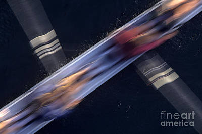 Photograph - Crew Rowing Along Montlake Cut Sunrise Motion  by Jim Corwin