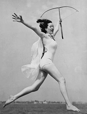 Exuberant Photograph - Crossbow Dancer by Underwood Archives