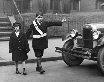 Adolescence Photograph - Crossing Guard Stops Traffic by Underwood Archives