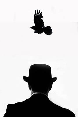 Photograph - Crow Flying Over Man by Grant Faint