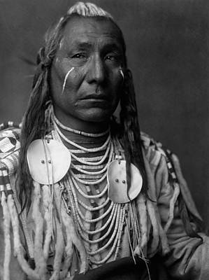 Portraits Royalty-Free and Rights-Managed Images - Crow Indian Man circa 1908 by Aged Pixel