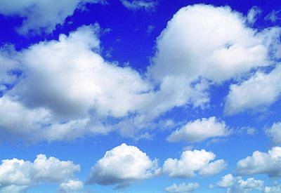 cumulus clouds in a blue sky photograph by pascal goetgheluck