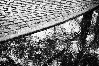 Photograph - Curb And Puddle In Rain by Dave Beckerman
