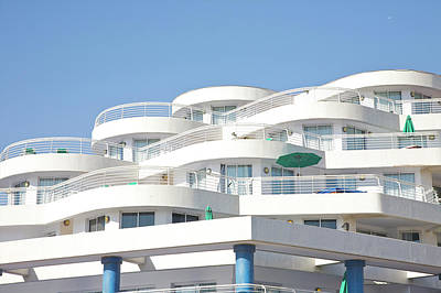 Balcony Photograph - Curved White Balcony Bands Under Blue by Barry Winiker