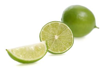 Photograph - Cut Limes by Science Photo Library
