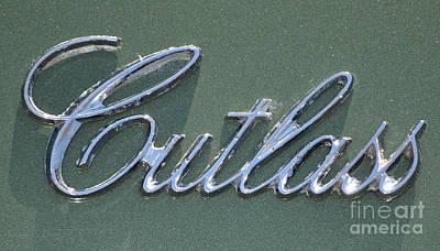 Photograph - Cutlass Badge by Mark Spearman