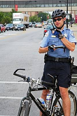 Police Officer Photograph - Cycling Policeman by Jim West
