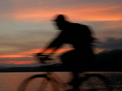 Photograph - Cyclist In Motion by Brian Chase