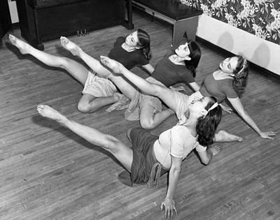 Full Skirt Photograph - Dancers Warmup Exercises by Underwood Archives