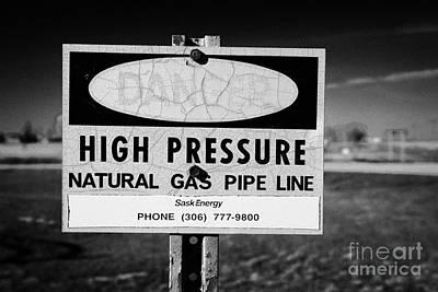 danger sign for high pressure natural gas pipeline underground bengough Saskatchewan Canada Art Print by Joe Fox