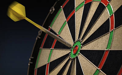 Photograph - Dart Hitting Bulls Eye On Dartboard by Ikon Images