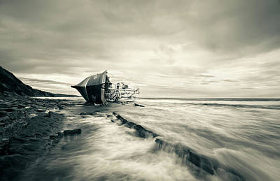 Shipwreck Wall Art - Photograph - Defeated By The Sea by I?igo Barandiaran