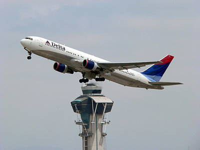 Photograph - Delta Jet Flying Over Lax Tower by Jeff Lowe