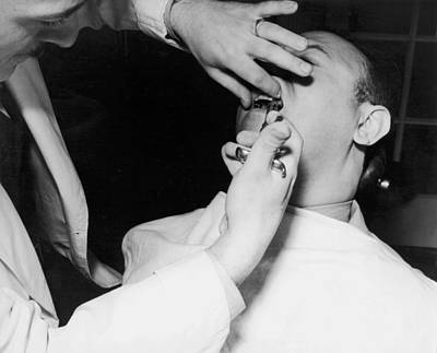 Dentist Photograph - Dentist Giving A Novocain Shot by Underwood Archives