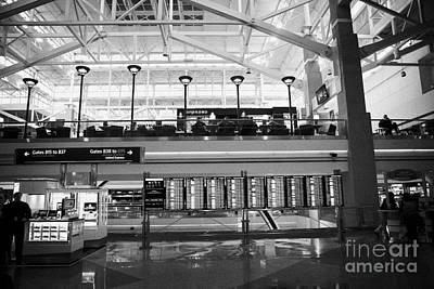 Airport Concourse Photograph - departures board at concourse b Denver International Airport Colorado USA by Joe Fox