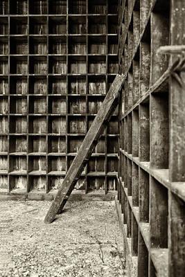 Derelict Wooden Storage Area Art Print by Russ Dixon