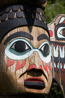 Bight Colors Photograph - Detail Of A Figure Carved Into A Totem by Kevin Smith