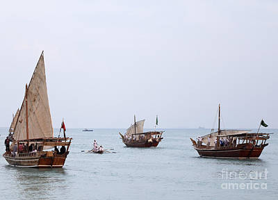 Photograph - Dhows Under Sail by Paul Cowan
