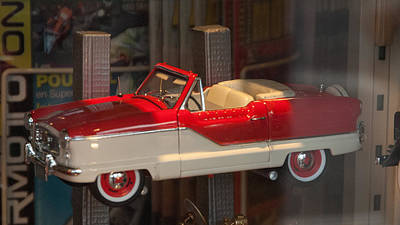 Photograph - Die Cast Red Metropolitan Convertible by Michael Flood