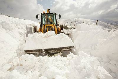 Digger Clearing Snow Drifts Art Print by Ashley Cooper