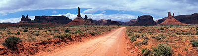 Dirt Roads Photograph - Dirt Road Through Desert Landscape by Panoramic Images