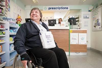Disabled Man In Pharmacy Art Print by Jim Varney