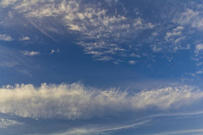 Photograph - Distant Clouds by David Pyatt