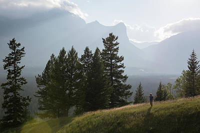 Photograph - Distant Hiker Holds Arms Outstretched by Ascent Xmedia