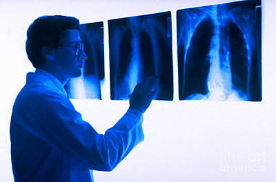 Doctor Views X-rays Art Print by Dennis Potokar