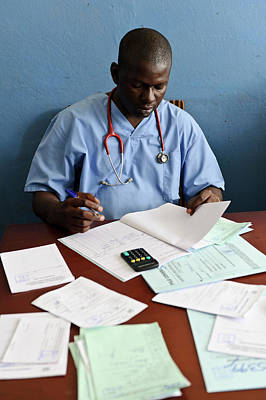 West Africa Photograph - Doctor With Patient Notes by Matthew Oldfield