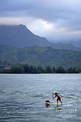 Dog And Man Paddleboarding In Hanalei Bay Art Print