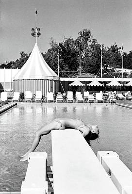 Diving Board Photograph - Donna Garrett Lying On A Diving Board by William Connors