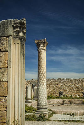 Clouds Rights Managed Images - Corinthian column at Volubilis in Morocco Royalty-Free Image by Patricia Hofmeester