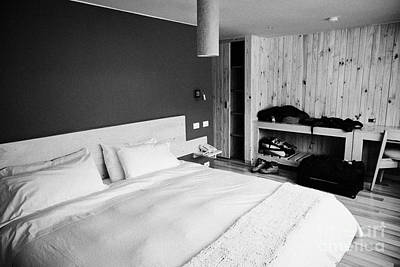 double bed in a new boutique hotel with luggage in the room in Punta Arenas Chile Art Print