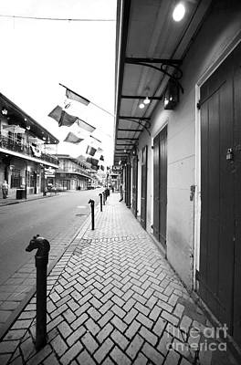 Bourbon Street Photograph - Down Bourbon Street by John Rizzuto