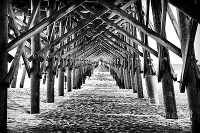 Photograph - Down Folly Beach Pier by John Rizzuto