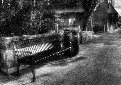 Black And White Photograph - Downtown Bench In Black And White by Greg Mimbs