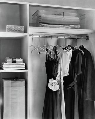 Dana-b-merrill Photograph - Dresses Hanging In A Closet by Dana B. Merrill