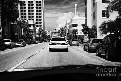 Driving Along Collins Ave In Miami South Beach Following A Yellow Cab Florida Usa Art Print by Joe Fox
