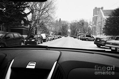 Driving Along Snow Covered Streets Looking For Onstreet Parking Saskatoon Saskatchewan Canada Print by Joe Fox