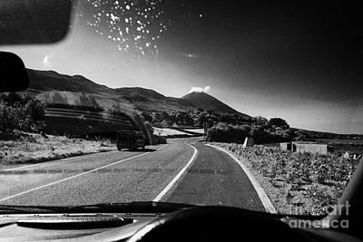 County Mayo Photograph - Driving Along The Coastal Road To Croagh Patrick County Mayo Republic Of Ireland by Joe Fox
