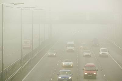 Motorway Photograph - Driving In Fog On The M1 Motorway by Ashley Cooper
