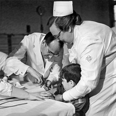 Scientist Photograph - Dr.jonas Salk Giving Vaccine by Underwood Archives