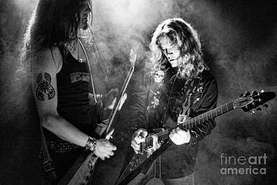 Troy Luccketta Photograph - Dueling Axes by Andrew Brooks