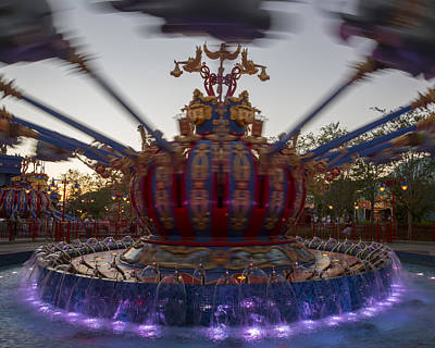 Color Photograph - Dumbo The Flying Elephant Ride At Dusk by Adam Romanowicz