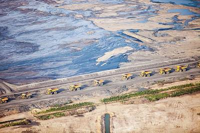 Oil Industry Photograph - Dump Trucks At Tar Sand Mine by Ashley Cooper