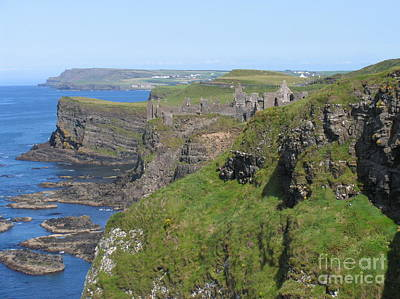 Photograph - Dunluce Castle On The Cliffs by Suzanne Oesterling